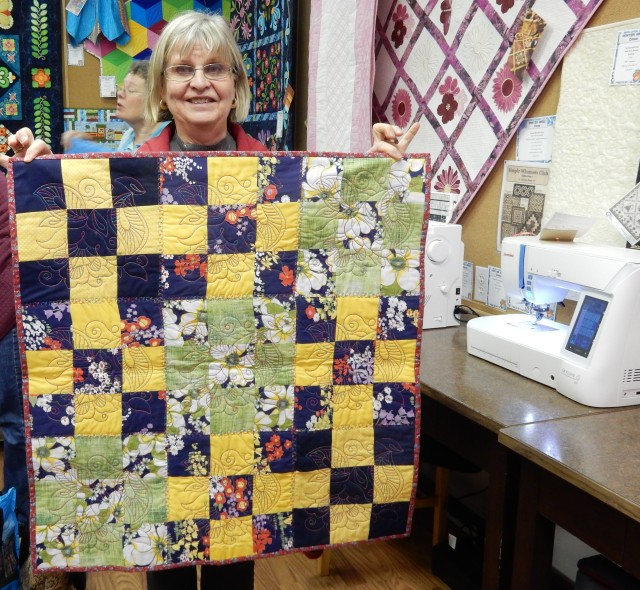 Another proud customer showing telling....this was a uilt madein one of the many classes offered in this store: to learn all about how to us ethe incredible Janome Acufil Quilting system. All the quilting was done in the ASQ22 hoop.