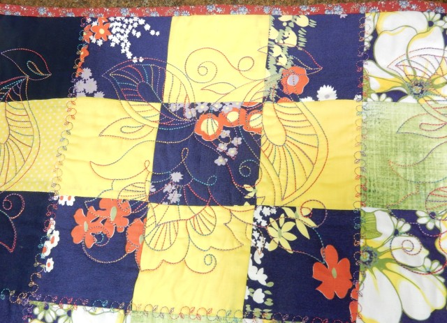 A close up showing one of the built-in quilting embroidery designs on the JANOME MC 15000