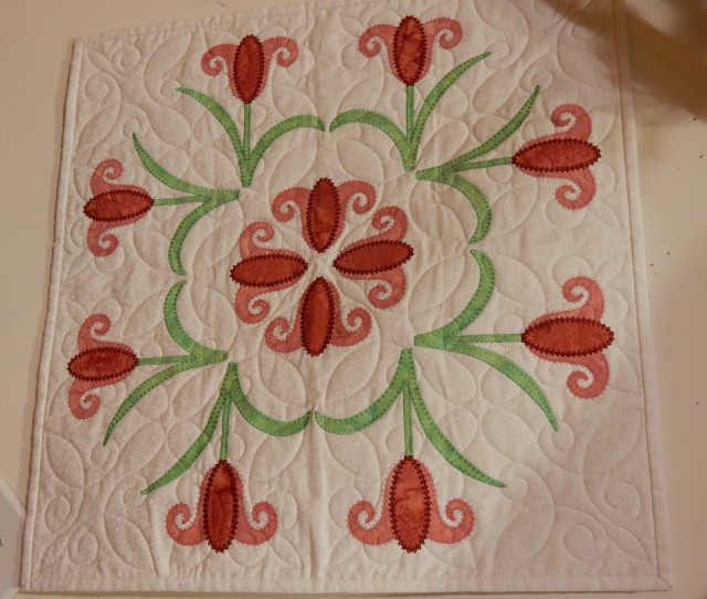 Another quilt on the wall - made by staff member, Donna who cut all the appliques with the Artistic Edge cutter and used Simple Cut software to digitize the applique-in-the-hoop.
