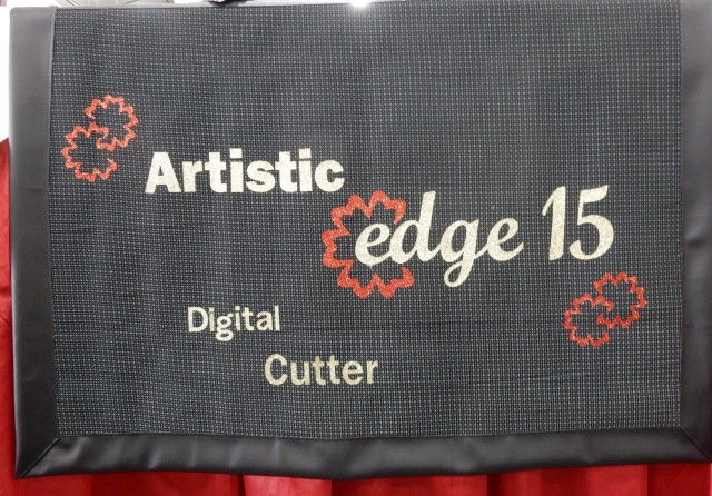 Our Artistic Edge Digital cutter banner got its debut! Everything on this was cut using the Edge 15 cutter - heat transfer glitter vinyl was used......SO much fun to work with and super quick.