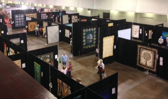 Part of the section where the National Juried Show quilts were on display. I think I heard there were 134 quilts juried into the show this year and of those, over 50 of them were first time entrants - way to go!!