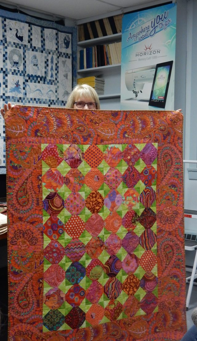Wendy - owner of Haus of Stitches - is just peeping above a vibrant quilt made with Kaffe Fasset fabrics. This was during one of the Show tell sessions.