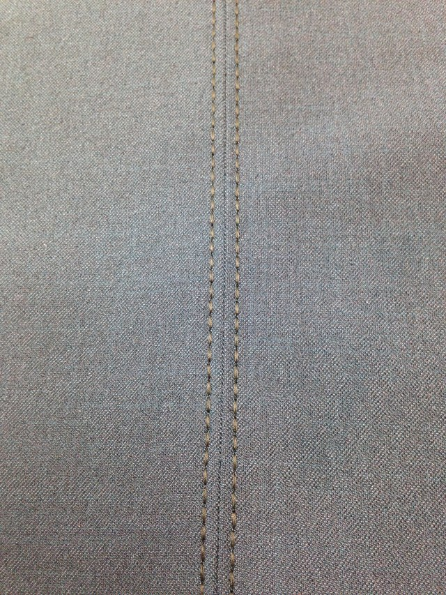 Ditch quilting foot was used to precisely top stitch this princess line seam on a pair of dress pants