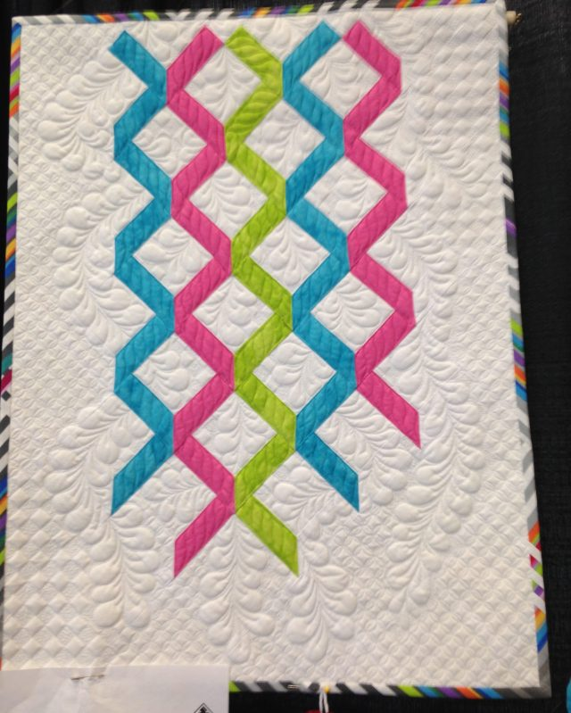 And I do believe this quilt was also made by Joanne Love of Whitehorse. This quilt is called Ribbons of Niagara