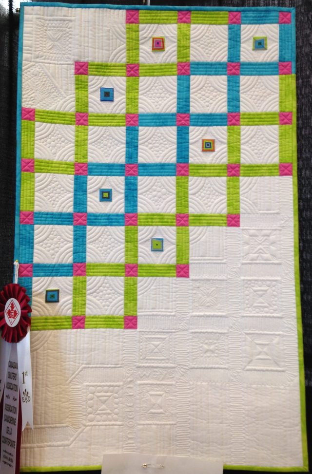 Yes, this quilt won a ribbon in the Trendtex Challenge at Quilt Canada in 2014 in St Catherines. This quilt was made by Joanne Love of Whitehorse, Yukon.