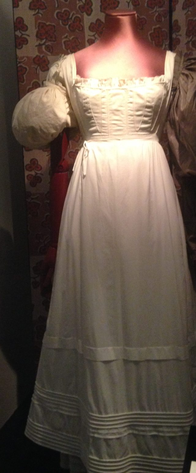 This is a cotton chemise dated 1820-1830. I am no expert on period clothing but I think a chemise was worn underneath a dress rather like a petticoat
