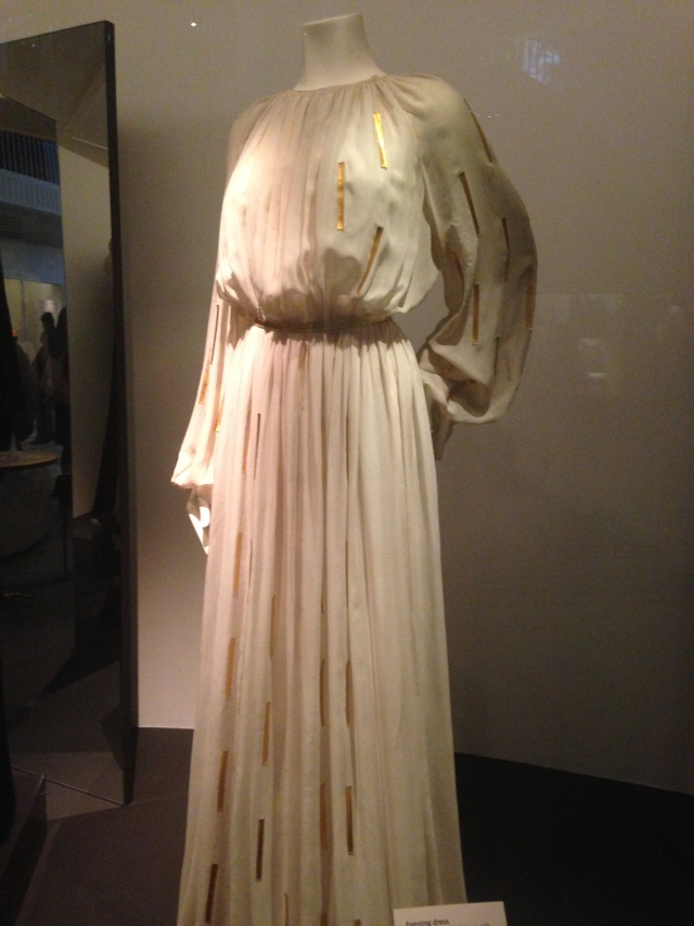 This evening gown was designed by Jeanne Lanvin 1967-1946 and is silk chiffon with gilded kid leather inset pieces.