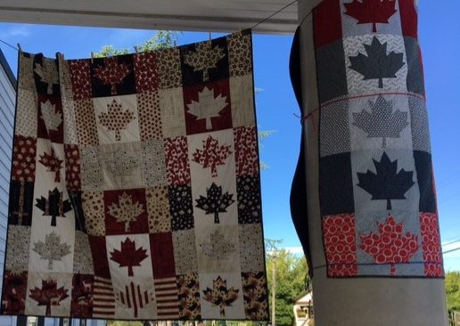 Hanging outside the entrance to the United church and the Quilts of Valour display