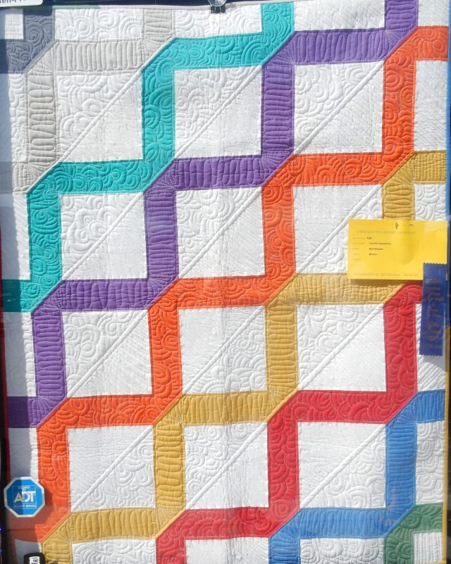This quilt was made by Matt Wheeler : Colourful Geometrics
