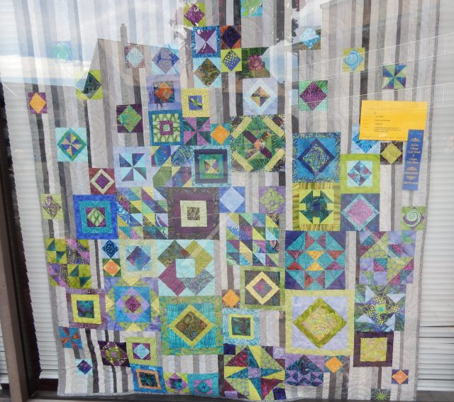 Lots of reflection on this window which is a pity as I was interested in this one. First saw it a couple of months ago at The Saskatchewan Stitchers Conference. Dianna Janssen will be teaching it there next year. It is called The Gypsys Wife. This one was made by: Ursula Von Hertzberg