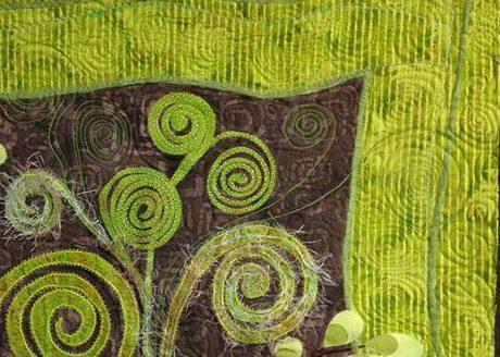 Some of my thread doddlings of spiral fiddlehead fern motifs - a lot of fun
