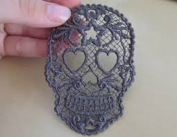 This stand alone lace embroidery also requires water soluble......anyone for halloween embroideries? We found this on etsy.com