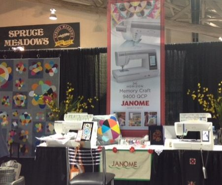 The Calgary show is held at the prestigous Spruce Meadows horse show venue just south of Calgary. Here we see more of Cynthias quilt as well as her lovely matching applique pillow next to the Janome machines.