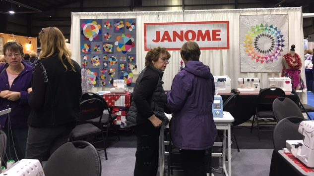 Our dealers busy assisting Janome customers on our Janome booth