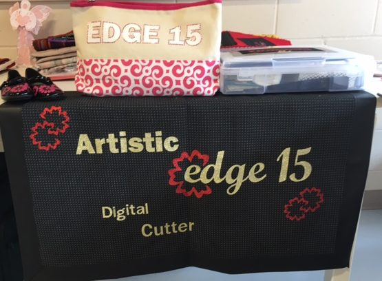 Artistic Edge 15 Digital cutter display. All the striking gold and red lettering was cut on the Edge digital cutter and simply were then ironed onto my banner. It is iron-on glitter vinyl