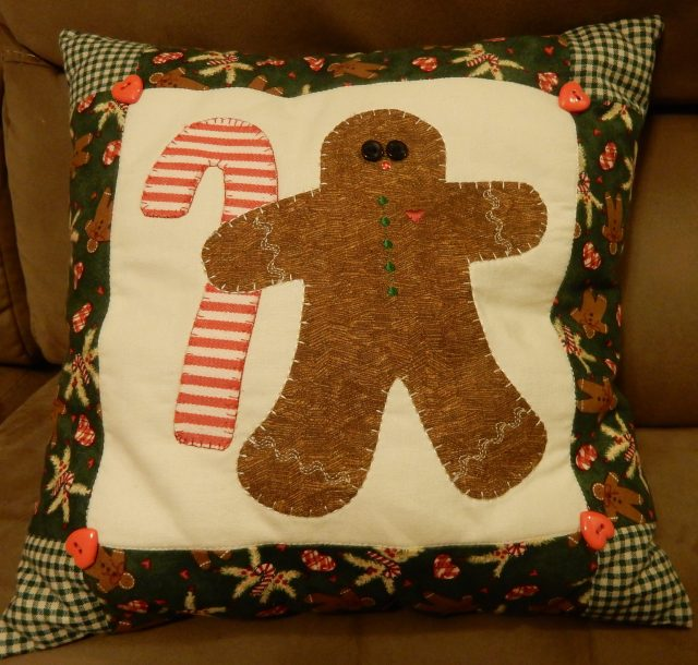 And what would Christmas be without candy canes gingerbread men? We did appliques on a simple little holiday pillow.