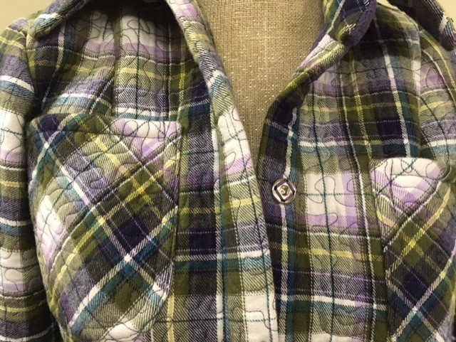 So what Linda appears to have done is fuse or glue a layer of plaid flannel to a layer of fleece and then acufil quilting the yardage. She then cut out the pattern pieces and sewed it all up into the jacket/thick shirt.