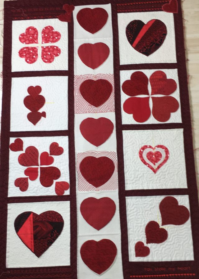 Never have go around to binding this wall hanging......bad girl. But I do like it as it is a collection of many appliqued hearts and well over 6 different techniques for botht he appliue and the quilting. I used janome Digitizer MBX for several differnt quilting-in=the-hoop techniques echo, stippling, etc) + Acufil quilting + regular free motion stippling and more.