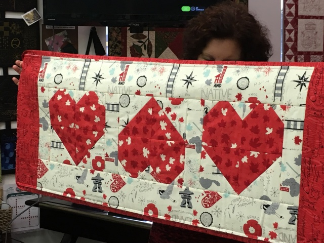Tammy hiding behind her lovely heart table runner