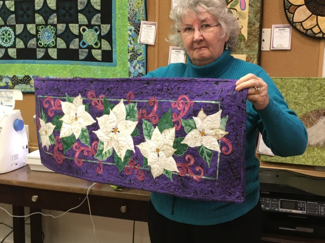 Barb showing her lovely poinsetta table runner