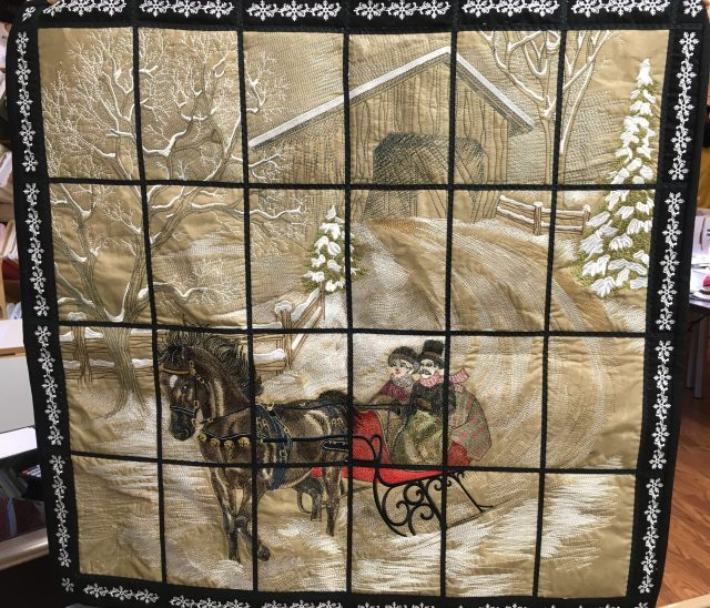 So did this one get oohs aaahs......Doris used the tiled embroidery collection from www.janome-embroidery.cim to make this Dashing through the snow mural. Each block and the border is machine embroidered and then cleverly sewed together for the tiled/window pane scene. Stunning!